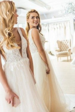 How Much Money Should I Put Aside for Dress Alterations?